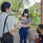 The Peer Facilitators of the Teen Support Group of the City Population Management Office of Gen Santos City distributing SPEAK-UP fans and leaflets to young people in malls, city plaza before Valentine's Day